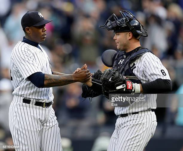 Aroldis Chapman and Brian McCann of the New York Yankees celebrate the win after the game against the Chicago White Sox at Yankee Stadium on May 15...
