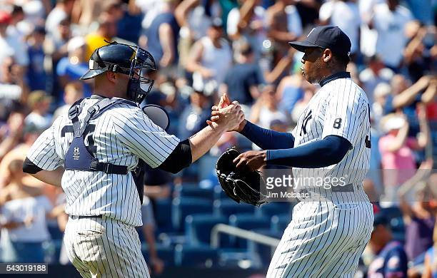 Aroldis Chapman and Brian McCann of the New York Yankees celebrate after defeating the Minnesota Twins at Yankee Stadium on June 25 2016 in the Bronx...
