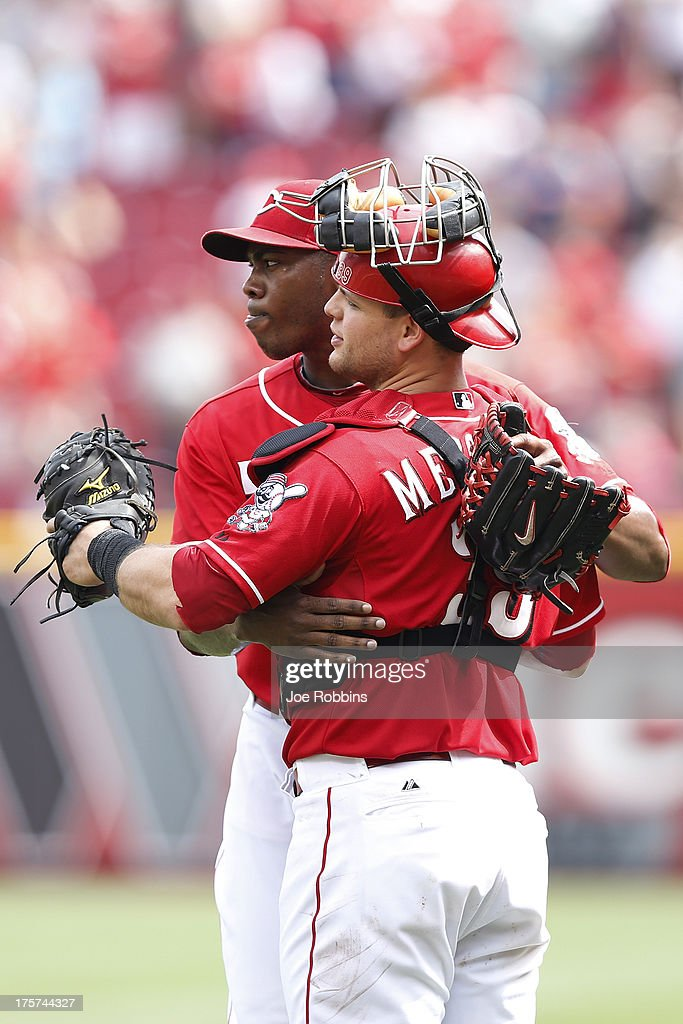 <a gi-track='captionPersonalityLinkClicked' href=/galleries/search?phrase=Aroldis+Chapman&family=editorial&specificpeople=5753195 ng-click='$event.stopPropagation()'>Aroldis Chapman</a> #54 and <a gi-track='captionPersonalityLinkClicked' href=/galleries/search?phrase=Devin+Mesoraco&family=editorial&specificpeople=5745587 ng-click='$event.stopPropagation()'>Devin Mesoraco</a> #39 of the Cincinnati Reds celebrate after the game against the Oakland Athletics at Great American Ball Park on August 7, 2013 in Cincinnati, Ohio. The Reds won 6-5.