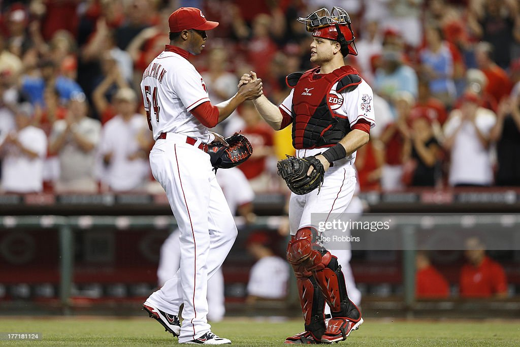 <a gi-track='captionPersonalityLinkClicked' href=/galleries/search?phrase=Aroldis+Chapman&family=editorial&specificpeople=5753195 ng-click='$event.stopPropagation()'>Aroldis Chapman</a> #54 and <a gi-track='captionPersonalityLinkClicked' href=/galleries/search?phrase=Devin+Mesoraco&family=editorial&specificpeople=5745587 ng-click='$event.stopPropagation()'>Devin Mesoraco</a> #39 of the Cincinnati Reds celebrate after the game against the Arizona Diamondbacks at Great American Ball Park on August 21, 2013 in Cincinnati, Ohio. The Reds won 10-7.