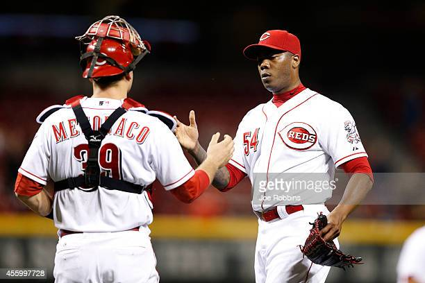 Aroldis Chapman and Devin Mesoraco of the Cincinnati Reds celebrate after the game against the Milwaukee Brewers at Great American Ball Park on...