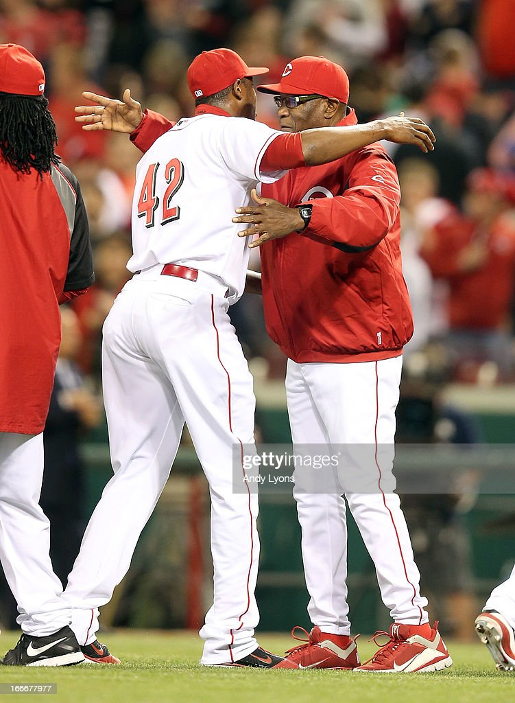 <a gi-track='captionPersonalityLinkClicked' href=/galleries/search?phrase=Aroldis+Chapman&family=editorial&specificpeople=5753195 ng-click='$event.stopPropagation()'>Aroldis Chapman</a> and <a gi-track='captionPersonalityLinkClicked' href=/galleries/search?phrase=Dusty+Baker&family=editorial&specificpeople=202908 ng-click='$event.stopPropagation()'>Dusty Baker</a> the manager of the Cincinnati Reds celebrates after the last out during the game against the Philadelphia Phillies at Great American Ball Park on April 15, 2013 in Cincinnati, Ohio. All uniformed team members are wearing jersey number 42 in honor of Jackie Robinson Day. The Reds won 4-2.