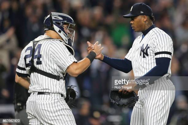 Aroldis Chapman and Gary Sanchez of the New York Yankees celebrate after the Yankees defeated the Houston Astros in Game 4 of the American League...