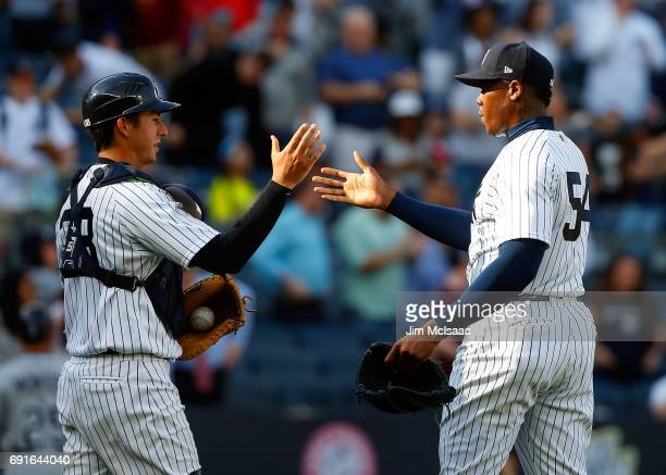 Aroldis Chapman and Kyle Higashioka of the New York Yankees celebrate against the Tampa Bay Rays at Yankee Stadium on April 12 2017 in the Bronx...
