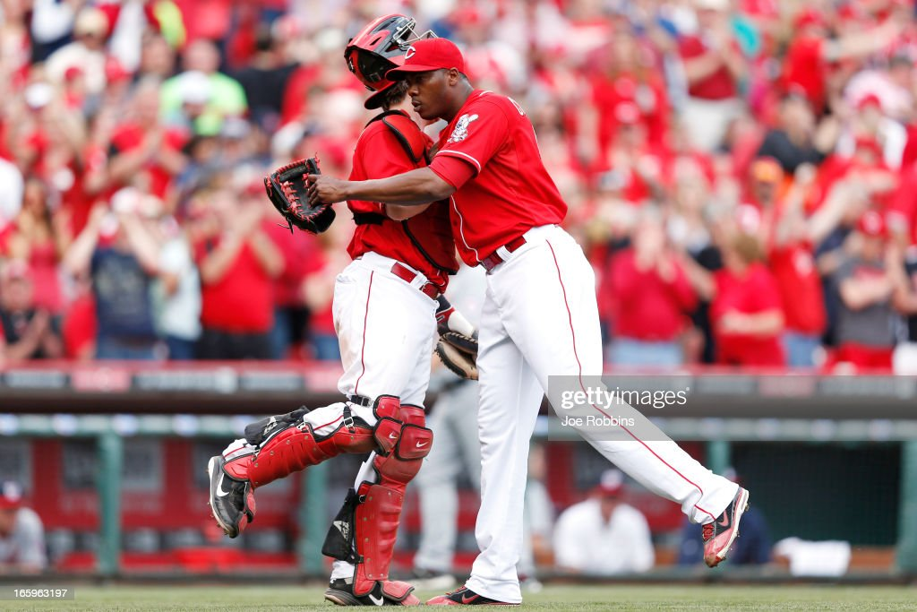<a gi-track='captionPersonalityLinkClicked' href=/galleries/search?phrase=Aroldis+Chapman&family=editorial&specificpeople=5753195 ng-click='$event.stopPropagation()'>Aroldis Chapman</a> #54 and <a gi-track='captionPersonalityLinkClicked' href=/galleries/search?phrase=Ryan+Hanigan&family=editorial&specificpeople=833982 ng-click='$event.stopPropagation()'>Ryan Hanigan</a> #29 of the Cincinnati Reds celebrate after the game against the Washington Nationals at Great American Ball Park on April 7, 2013 in Cincinnati, Ohio. The Reds won 6-3.