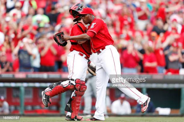 Aroldis Chapman and Ryan Hanigan of the Cincinnati Reds celebrate after the game against the Washington Nationals at Great American Ball Park on...