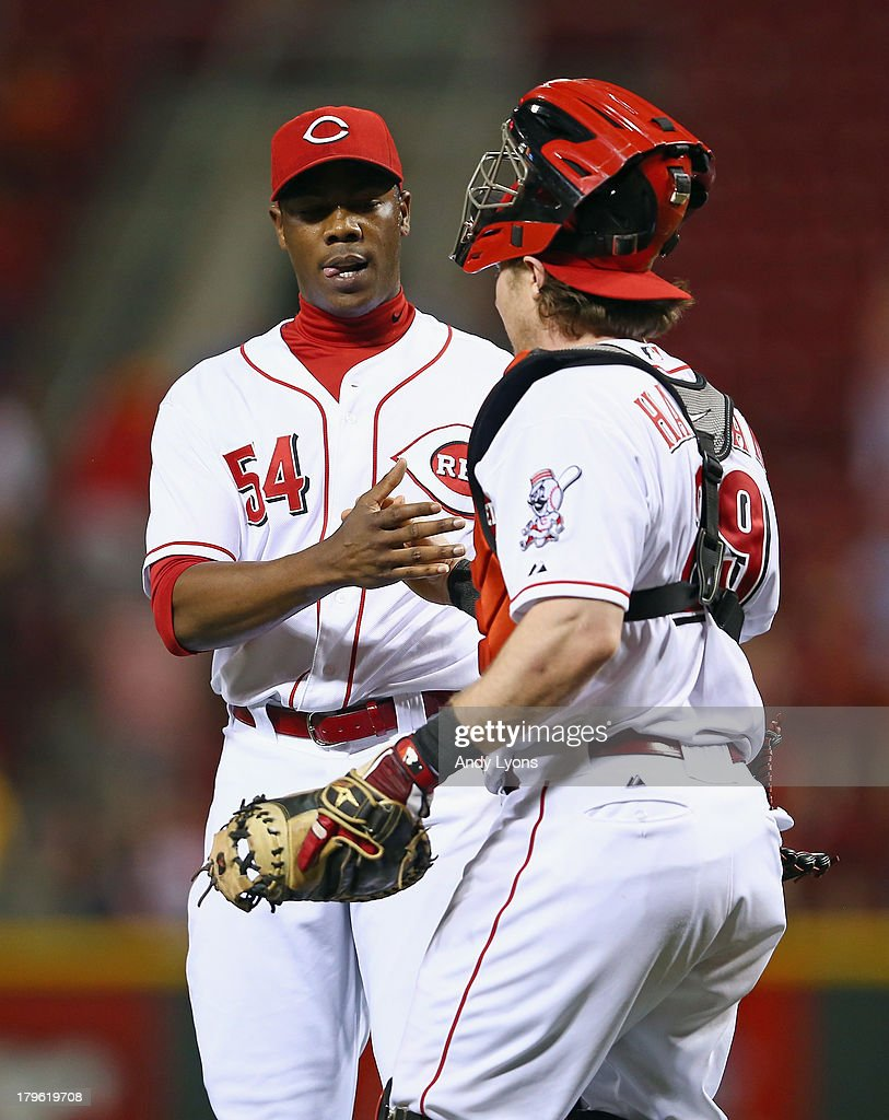 Aroldis Chapman #54 and Ryan Hanigan #29 of the Cincinnati Reds celebrate after the game against the St. Louis Cardinals at Great American Ball Park on September 5, 2013 in Cincinnati, Ohio.