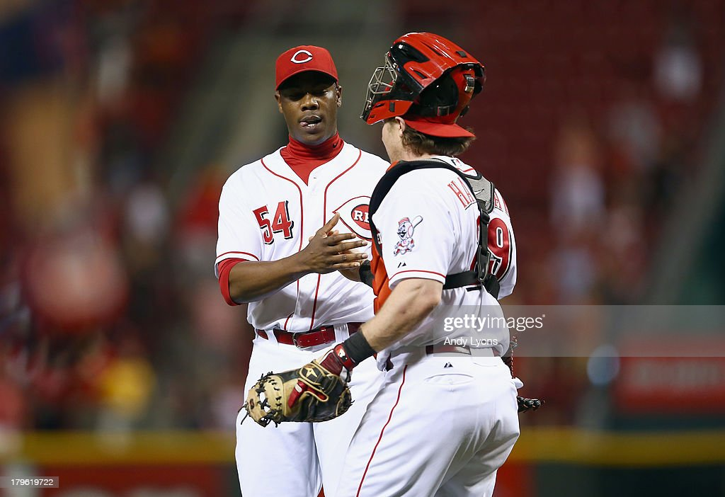 <a gi-track='captionPersonalityLinkClicked' href=/galleries/search?phrase=Aroldis+Chapman&family=editorial&specificpeople=5753195 ng-click='$event.stopPropagation()'>Aroldis Chapman</a> #54 and <a gi-track='captionPersonalityLinkClicked' href=/galleries/search?phrase=Ryan+Hanigan&family=editorial&specificpeople=833982 ng-click='$event.stopPropagation()'>Ryan Hanigan</a> #29 of the Cincinnati Reds celebrate after the game against the St. Louis Cardinals at Great American Ball Park on September 5, 2013 in Cincinnati, Ohio.