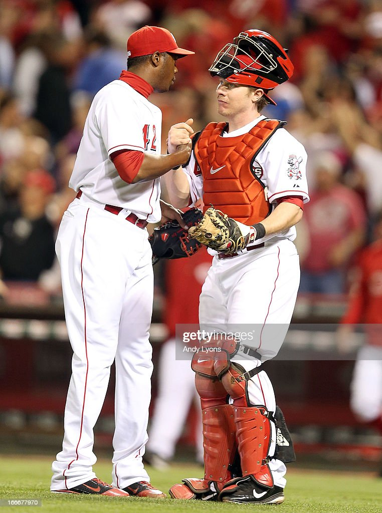<a gi-track='captionPersonalityLinkClicked' href=/galleries/search?phrase=Aroldis+Chapman&family=editorial&specificpeople=5753195 ng-click='$event.stopPropagation()'>Aroldis Chapman</a> and <a gi-track='captionPersonalityLinkClicked' href=/galleries/search?phrase=Ryan+Hanigan&family=editorial&specificpeople=833982 ng-click='$event.stopPropagation()'>Ryan Hanigan</a> of the Cincinnati Reds celebrates after the last out during the game against the Philadelphia Phillies at Great American Ball Park on April 15, 2013 in Cincinnati, Ohio. All uniformed team members are wearing jersey number 42 in honor of Jackie Robinson Day. The Reds won 4-2.