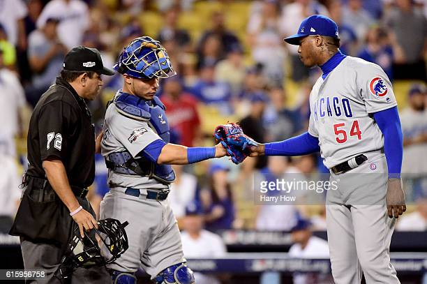Aroldis Chapman and Willson Contreras of the Chicago Cubs celebrate the Cubs 84 victory against the Los Angeles Dodgers in game five of the National...