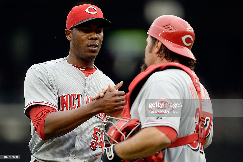 <a gi-track='captionPersonalityLinkClicked' href=/galleries/search?phrase=Aroldis+Chapman&family=editorial&specificpeople=5753195 ng-click='$event.stopPropagation()'>Aroldis Chapman</a> #54 celebrates with <a gi-track='captionPersonalityLinkClicked' href=/galleries/search?phrase=Corky+Miller&family=editorial&specificpeople=224796 ng-click='$event.stopPropagation()'>Corky Miller</a> #37 of the Cincinnati Reds after the Reds defeated the Washington Nationals 5-2 during a game at Nationals Park on April 28, 2013 in Washington, DC.