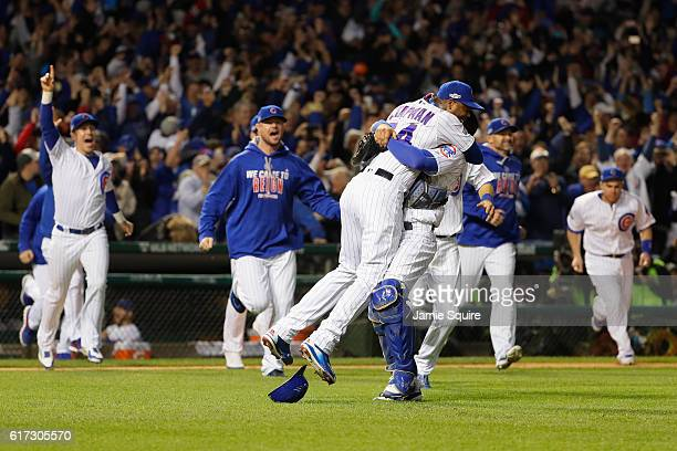 Aroldis Chapman celebrates with Willson Contreras of the Chicago Cubs after defeating the Los Angeles Dodgers 50 in game six of the National League...