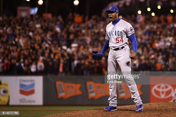 Aroldis Chapman of the Chicago Cubs celebrates after defeating the San Francisco Giants 65 in Game Four of their National League Division Series to...