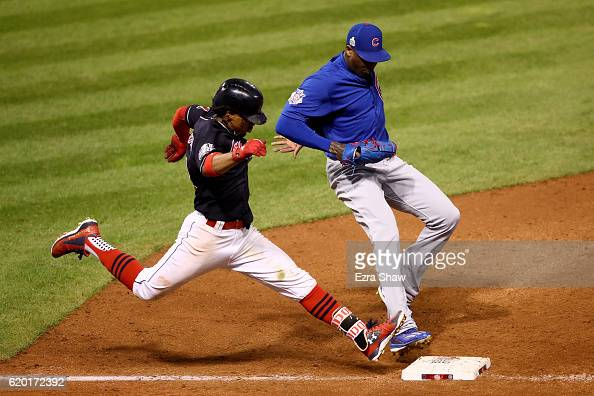 Aroldis Chapman of the Chicago Cubs forces out Francisco Lindor of the Cleveland Indians at first base to end the seventh inning in Game Six of the...