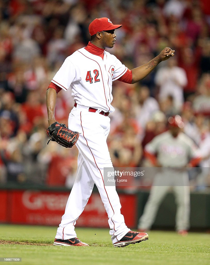 <a gi-track='captionPersonalityLinkClicked' href=/galleries/search?phrase=Aroldis+Chapman&family=editorial&specificpeople=5753195 ng-click='$event.stopPropagation()'>Aroldis Chapman</a> of the Cincinnati Reds celebrates after the last out during the game against the Philadelphia Phillies at Great American Ball Park on April 15, 2013 in Cincinnati, Ohio. All uniformed team members are wearing jersey number 42 in honor of Jackie Robinson Day.