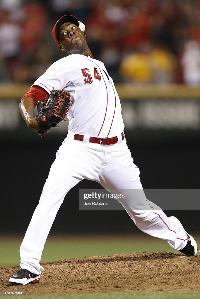 <a gi-track='captionPersonalityLinkClicked' href=/galleries/search?phrase=Aroldis+Chapman&family=editorial&specificpeople=5753195 ng-click='$event.stopPropagation()'>Aroldis Chapman</a> #54 of the Cincinnati Reds pitches the ninth inning of the game against the Oakland Athletics at Great American Ball Park on August 6, 2013 in Cincinnati, Ohio. The Reds won 3-1.