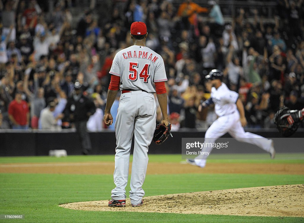 <a gi-track='captionPersonalityLinkClicked' href=/galleries/search?phrase=Aroldis+Chapman&family=editorial&specificpeople=5753195 ng-click='$event.stopPropagation()'>Aroldis Chapman</a> #54 of the Cincinnati Reds stands on the mound after he gave up a walk-off two run homer to Chris Denorfia #13 of the San Diego Padres during the ninth inning of a baseball game at Petco Park on July 29, 2013 in San Diego, California. The Padres won 2-1.