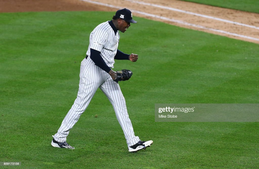 Aroldis Chapman #54 of the New York Yankees celebrates after defeating the Cleveland Indians in game three of the American League Division Series at Yankee Stadium on October 8, 2017 in New York City.