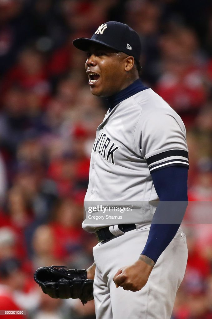 Aroldis Chapman #54 of the New York Yankees celebrates their 5 to 2 win over the Cleveland Indians in Game Five of the American League Divisional Series at Progressive Field on October 11, 2017 in Cleveland, Ohio.
