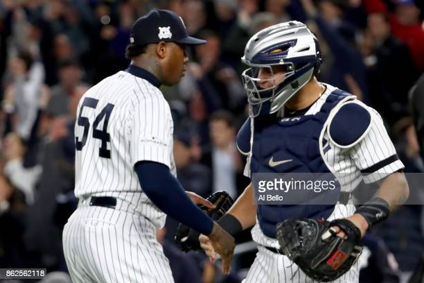 Aroldis Chapman of the New York Yankees celebrates with Gary Sanchez after defeating the Houston Astros in Game Four of the American League...