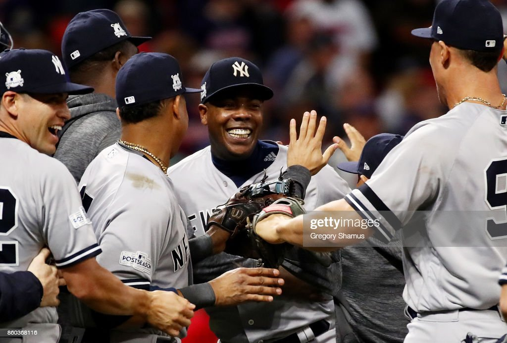 Aroldis Chapman #54 of the New York Yankees celebrates with teammates after their 5 to 2 win over the Cleveland Indians in Game Five of the American League Divisional Series at Progressive Field on October 11, 2017 in Cleveland, Ohio.