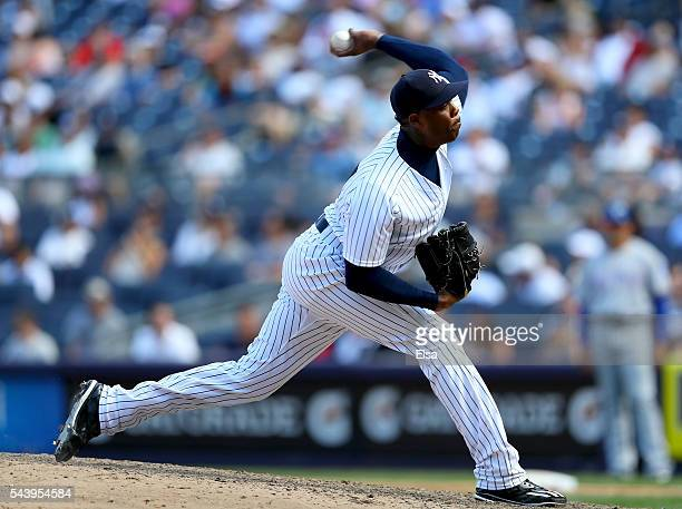 Aroldis Chapman of the New York Yankees delivers a pitch in the ninth inning against the Texas Rangers at Yankee Stadium on June 30 2016 in the Bronx...