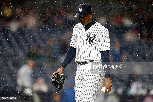 Aroldis Chapman of the New York Yankees looks on before a rain delay against the Texas Rangers at Yankee Stadium on June 27 2016 in the Bronx borough...