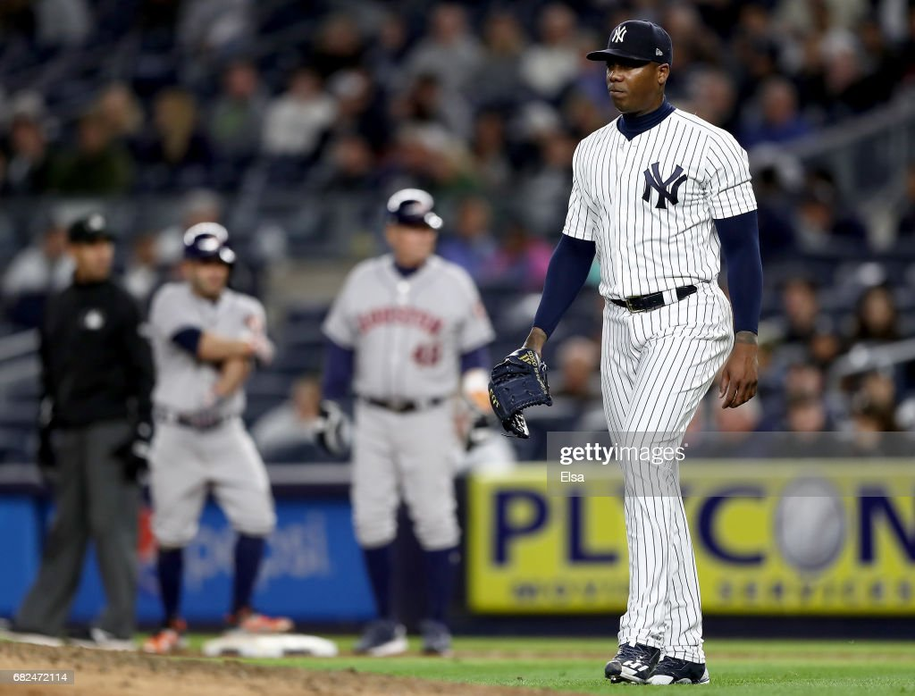 Aroldis Chapman #54 of the New York Yankees reacts as he is about to be pulled from the game against the New York Yankees in the ninth inning on May 12, 2017 at Yankee Stadium in the Bronx borough of New York City.
