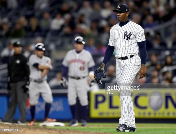 Aroldis Chapman of the New York Yankees reacts as he is about to be pulled from the game against the New York Yankees in the ninth inning on May 12...