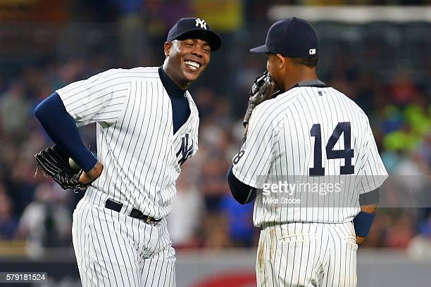 Aroldis Chapman of the New York Yankees shares a laugh with Starlin Castro during the ninth inning against the San Francisco Giants at Yankee Stadium...