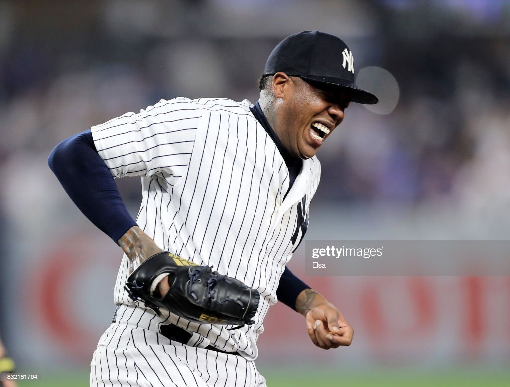 Aroldis Chapman #54 of the New York Yankees winces in pain as he make the final out at first base in the ninth inning against the New York Mets during interleague play on August 15, 2017 at Yankee Stadium in the Bronx borough of New York City.