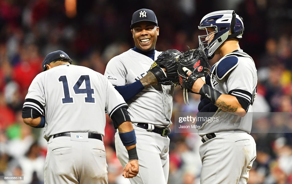 Aroldis Chapman #54, Starlin Castro #14 and Gary Sanchez #24 of the New York Yankees celebrate in the ninth inning against the Cleveland Indians in Game Five of the American League Divisional Series at Progressive Field on October 11, 2017 in Cleveland, Ohio.