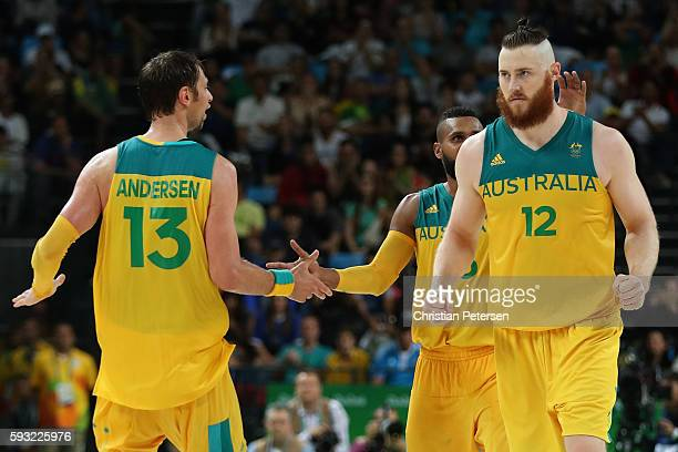 Aron Baynes of Australia Patty Mills of Australia and David Andersen of Australia celebrate during the Men's Basketball Bronze medal game between...