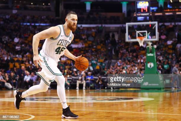 Aron Baynes of the Boston Celtics dribbles against the Charlotte Hornets during the second half at TD Garden on October 2 2017 in Boston...