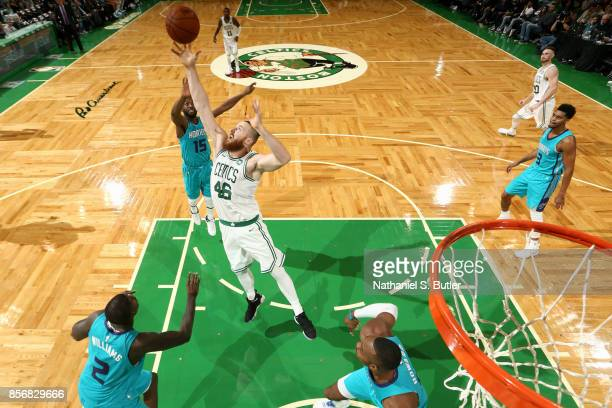 Aron Baynes of the Boston Celtics grabs the rebound against the Charlotte Hornets on October 2 2017 at the TD Garden in Boston Massachusetts NOTE TO...