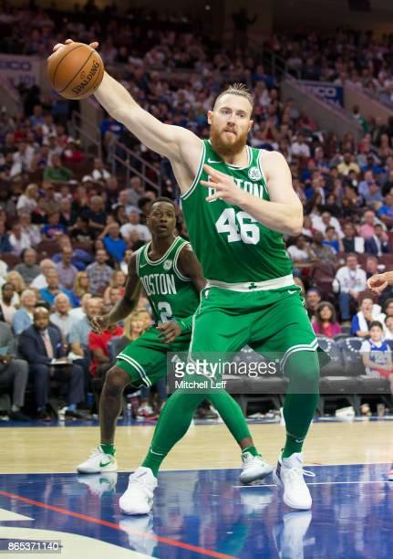 Aron Baynes of the Boston Celtics reaches for the ball against the Philadelphia 76ers at the Wells Fargo Center on October 20 2017 in Philadelphia...
