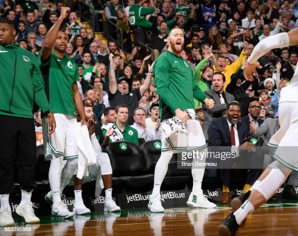 Aron Baynes of the Boston Celtics with his teammates react to a play against the Philadelphia 76ers on November 30 2017 at the TD Garden in Boston...