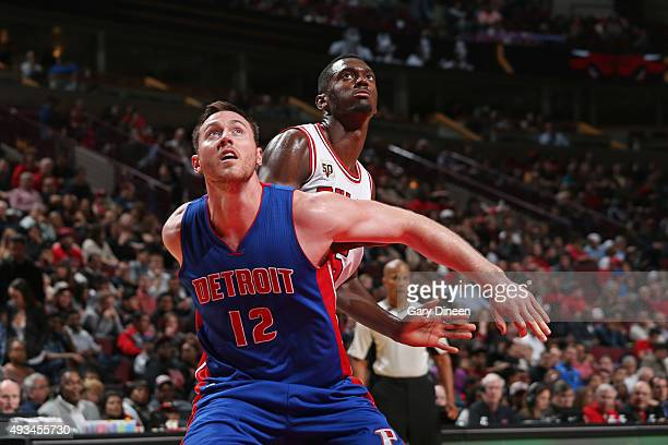 Aron Baynes of the Detroit Pistons boxes out Bobby Portis of the Chicago Bulls during the preseason game on October 14 2015 at United Center in...