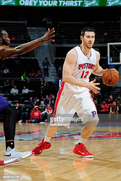 Aron Baynes of the Detroit Pistons drives to the basket against the Charlotte Hornets on October 21 2015 at The Palace of Auburn Hills in Auburn...