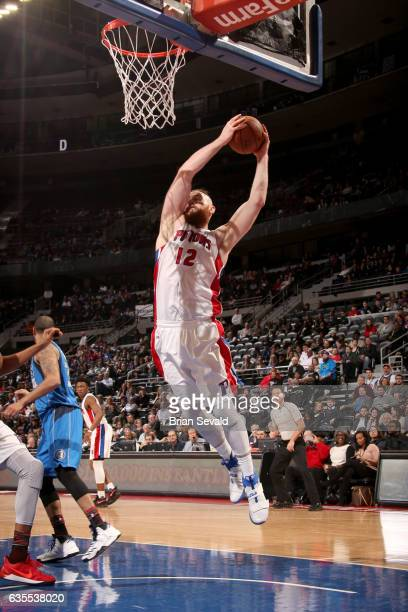 Aron Baynes of the Detroit Pistons grabs the rebound against the Dallas Mavericks on February 15 2017 at The Palace of Auburn Hills in Auburn Hills...