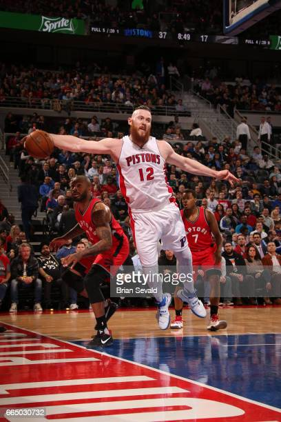 Aron Baynes of the Detroit Pistons grabs the rebound against the Toronto Raptors on April 5 2017 at The Palace of Auburn Hills in Auburn Hills...