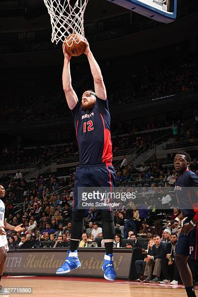 Aron Baynes of the Detroit Pistons grabs the rebound during a game against the Orlando Magic on December 4 2016 at The Palace of Auburn Hills in...