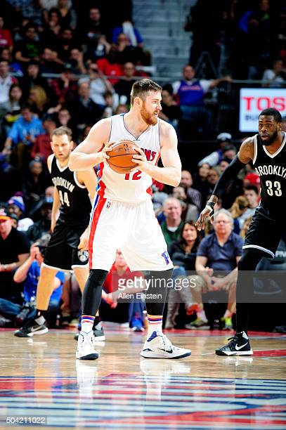 Aron Baynes of the Detroit Pistons handles the ball against the Brooklyn Nets on January 9 2016 at The Palace of Auburn Hills in Auburn Hills...