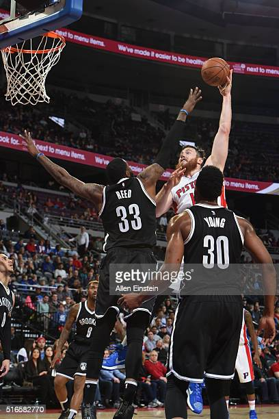 Aron Baynes of the Detroit Pistons shoots against Willie Reed of the Brooklyn Nets during the game on March 19 2016 at The Palace of Auburn Hills in...