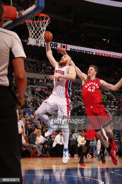 Aron Baynes of the Detroit Pistons shoots the ball against the Toronto Raptors on April 5 2017 at The Palace of Auburn Hills in Auburn Hills Michigan...