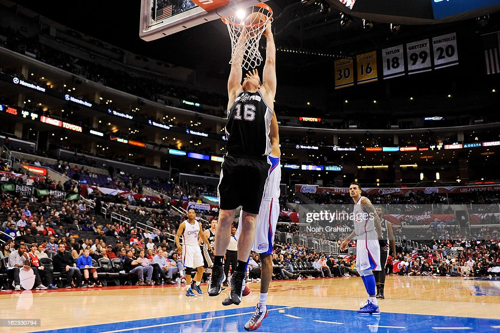 Aron Baynes #16 of the San Antonio Spurs dunks against the Los Angeles Clippers at Staples Center on February 21, 2013 in Los Angeles, California.