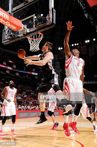 Aron Baynes of the San Antonio Spurs goes up for a layup against the Houston Rockets during the game on October 24 2014 at the Toyota Center in...