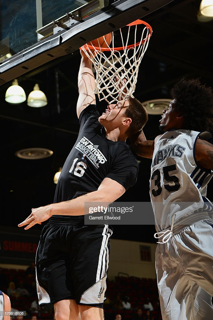 Aron Baynes #16 of the San Antonio Spurs goes up for the dunk against the Atlanta Hawks during NBA Summer League on July 15, 2013 at the Cox Pavilion in Las Vegas, Nevada.