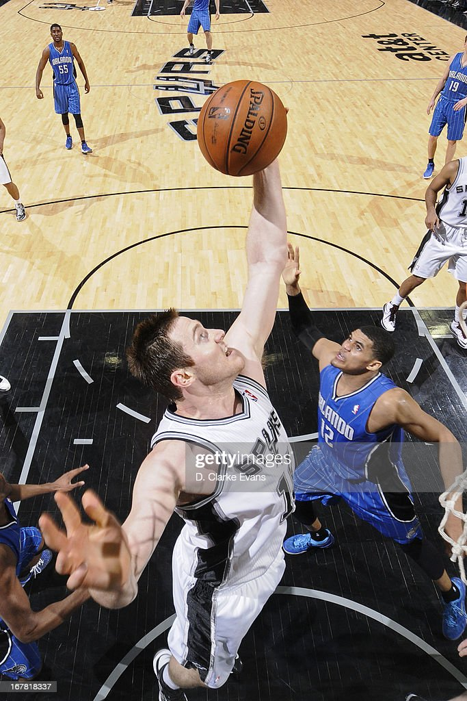 Aron Baynes #16 of the San Antonio Spurs grabs a rebound against <a gi-track='captionPersonalityLinkClicked' href=/galleries/search?phrase=Tobias+Harris&family=editorial&specificpeople=6902922 ng-click='$event.stopPropagation()'>Tobias Harris</a> #12 of the Orlando Magic on April 3, 2013 at the AT&T Center in San Antonio, Texas.