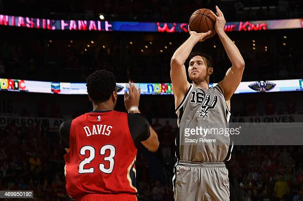 Aron Baynes of the San Antonio Spurs is defended by Anthony Davis of the New Orleans Pelicans during a game at the Smoothie King Center on April 15...